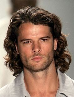 wavy shoulder length hairstyle for man
