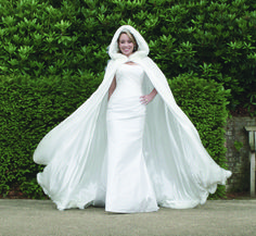 My favorite so far. White slim fitting dress with accent cape. Perfect for a winter wedding in the snow!