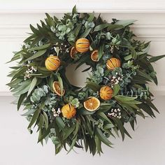 Orange Eucalyptus Wreath - $89.00»  I love the look of decorating with fruit for the holidays. This fragrant wreath is a pretty combination of eucalyptus leaves and dried oranges.