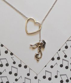Music Necklace with Heart, Clef, Music Note and Joy Charm, handmade jewelry. $22.00, via Etsy.