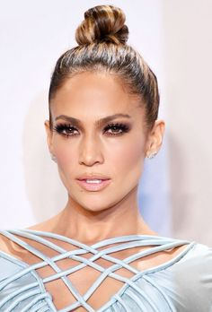 Jennifer Lopez's super-sleek topknot, smoky eyes, and lush lashes are absolutely perfect