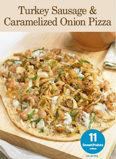 Weight Watchers® SmartPoints®: 11 per serving Serves 1 1 Flatout flatbread, we used Light Original 1/4 medium Vidalia onion, thinly sliced, sautéed until caramelized 1/2 cup (about 2.4 oz) cooked turkey sausage, sliced in coins 1/4 cup reduced-fat crumbled blue cheese 1/3 cup 2% or part skim shredded mozzarella cheese Salt and freshly ground pepper Continue Reading...