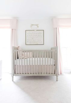 lay baby lay classic, polished pink nursery reveal. featuring our marcelle crib, little star appliqué bedding collection, hush little baby sheet music and wool felt bunny mobile.