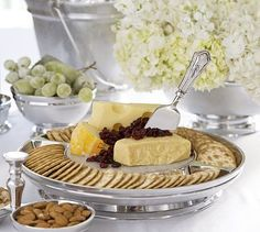 "Chancellor Small Round Cheese Board  13.25"" diameter, 2"" high Features an inset of Carrara marble for serving cheese. Sand-cast of aluminum and polished by hand for a rich luster pottery barn $69.00"