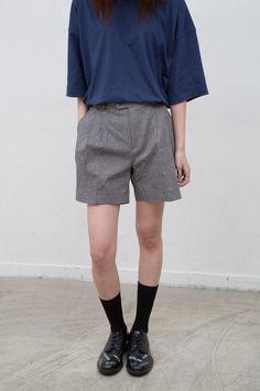 Wool shorts, oversized navy tshirt, black socks