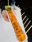 Cantaloupe Lollipops with Crispy Prosciutto (appetizer)