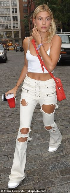 White hot: She added a splash of color with a red cross body purse and a pair of thick gold hoops
