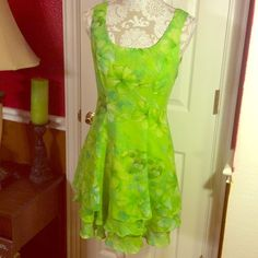 SALEFantastic green floral sleeveless dress Made in Cyprus Italy. 100% polyester dry clean only. Size 2, by Georgiou Studio. Is a fantastic floral dress with shades of green light green light blue and creamy white. I HATE to see this one go, but alas, I won't ever fit into this again! Georgiou Studio Dresses Midi