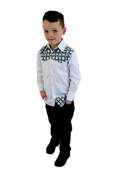 Boys Long Sleeves Fitted Shirts White enhanced with a fusion of African Print A blend of white cotton with a blue flowery patterned Ankara African print to help bring a regular white shirt to live. Thinking white shirts for boys are always boring? Think again!!! #DareToStandOut   For best fit, please reference the size chart.Product care; to keep the colours looking bright longer, hand wash is recommended.