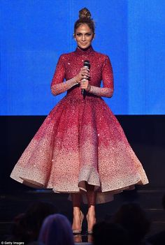 Dazzling: The host swapped her catsuit for a more demure, flared dress as she opened the show