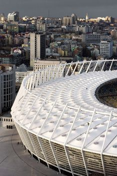 Completed in 2011 in Kiev, Ukraine. Images by Marcus Bredt. On the occasion of the UEFA European Football Championships in which Ukraine is staging jointly with Poland, the rebuilding of the Olympic. Soccer Stadium, Football Stadiums, Football Tournament, Places Around The World, Around The Worlds, Stadium Architecture, Circular Buildings, Round Building, Amazing Buildings