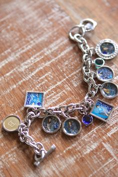 Personalized Photo Charm Bracelet, with birth stones and a Monogram Charm, from Shutterfly. Wouldn't this make a gorgeous Mother's Day Gift? Photo charms of the kiddos for Grandma!