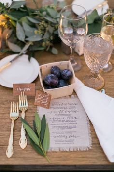 Add an organic touch to your tabletops with Danica Butler's custom lettering. The place cards are crafted out of wood veneer paper, and the hand-stamped menu is made out of natural linen with frayed edges. | Photo by Hello Love Photography