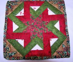 Christmas Octagonia Candle Mat is an interwoven piece of beauty!  Check this and other great gift ideas out at www.zibbet.com/quiltsforallreasons