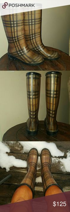 Burberry Rain/Snow boots. They go perfect with leggings and a black, white or grey dress. I would recomend putting shoe inserts inside them for extrea comfort! Perfect for cold weather with a warm fuzzy pair of socks! Size 9. Listing as 8.5 because you should wear comfortable inserts and socks.. which will than make you a 9 lol. ?? Amazingly durable. No scratches, no flaws 100% authentic. Burberry Shoes
