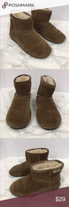 Bearpaw short brown boots furry 6 Suede upper in a boot style with a round toe Easy slip on entry Raised stitching with logo details Plush faux-fur lining with moisture-wicking comfort footbed TPR rubber traction outsole with shock absorption. Gently used. Extremely soft inside and no odors . BearPaw Shoes