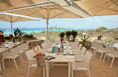 FORMENTERA - Juan y Andrea restaurant. sit with your feet in the sand and enjoy an amazing lunch by the beach. the beach has pink sands and the sea is full of harmless beautiful jellyfish. anything you order to eat at this fish restaurant is top of its class.