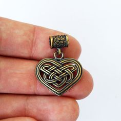 Celtic heart necklace  Production technology: casting Material: Brass Size: 1,22 inch or 31 mm  Payment: PayPal or Direct Checkout About shipping: https://www.etsy.com/shop/BDSartJewelry/policy?ref=shopinfo_policies_leftnav   All pendants come in gift box..