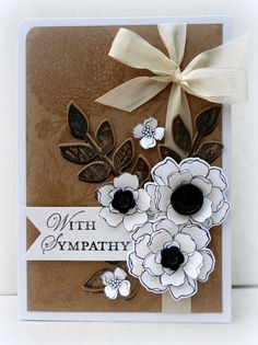 handmade sympathy card from White House Stamping   ... kraft base with tone on tone line art stamping ... bright white layered flowers made by stamping one flower several times, cutting out the layers and the assembling with dimensionals ... lovely ... Stampin' Up!