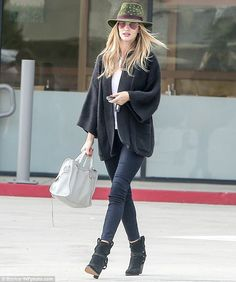 Day off: The 27-year-old beauty wrapped up in a pair of skinny jeans, ankle boots and a lo...