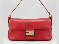 """$1480 - Leather Shoulder Baguette  This cleanly crafted leather Fendi baguette offers any look a timeless sensibility. Supple calfskin with golden hardware. Flat shoulder strap has 5"""" drop; enamel detailed attachments. Front flap with enamel Zucca detail and magnetic closure. Striped fabric lining; inside zip pocket. 9""""H x 14""""W x 6""""D. Bag weight: 2lb. Made in Italy. (1111)"""