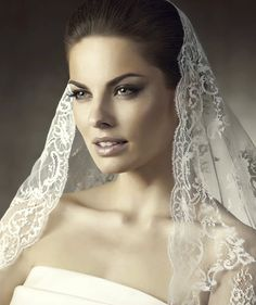 Google Image Result for http://wedding-pictures-05.onewed.com/34609/romantic-wedding-hair-accessories-mantilla-bridal-veils-by-pronovias-5.png