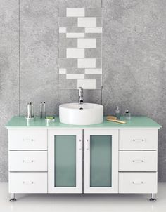 This beautiful modern vanity is a wonderful example of modern simplicity and sophistication. The vanity cabinet system features six sliding drawers with soft-close technology, and a spacious primary cabinet that will provide more than enough space for all your storage needs.
