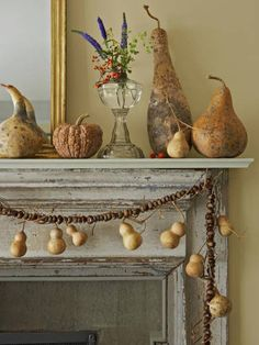 Dried gourds and squash form a still life on this mantel.
