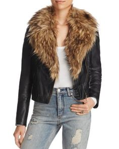 Free People's revved-up, faux-leather moto jacket flaunts a fierce, faux-fur collar that instantly accelerates your look with rock-chic edge. | Polyester; trim: acrylic; lining: rayon | Machine wash |