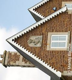 Decorative wood panels (gingerbread is what I like to call it) and brick work. Very victorian