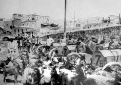 The first Targa Florio took place in 1906. The Isotta Fraschini team (cars #7) are lined up in Termini attended by goats.