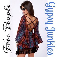 "Free People Gypsy Junkies RARE Boho Fringe Tunic RARE Gypsy Junkies for Free People Boho Bell Sleeve Fringe Tunic  Featuring: ~ multicolored boho/tribal design ~ bell sleeves ~ multi crisscross strap detailing upon a scoop back ~ fringe bottom hemline  Size: M/L   Length: 27""  Fair Offers & Bundle Discounts Available  No PP or Trade Offers Please  Free People Tops Tunics"