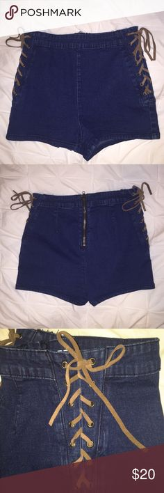 Urban Outfitters Jean shorts Urban outfitters dark wash high wasted shorts with brown suede lace up sides! Never warn and just-bought condition! Size 28. Urban Outfitters Shorts Jean Shorts