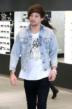 Proud father: Louis Tomlinson is making sure his son is his priority, with the Doncaster-b...