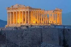 The Parthenon basking on the glow of the setting sun over Athens Greece.