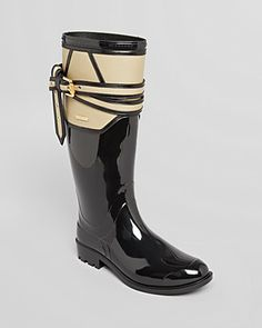 What: Rain boots Where: Burberry Why: Boots that are waterproof allow you to jump in puddles. I love the belt detailing which makes an otherwise ordinary boot more interesting!