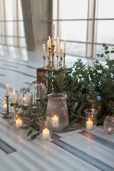organic wedding decor with candles and foliage