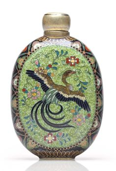 A cloisonné enamel scent bottle Meiji period (late 19th century), signed Kyoto Namikawa (workshop of Namikawa Yasuyuki; 1845-1927) The oval bottle decorated in polychrome enamels and gold and silver wires with panels designed with long-tailed bird and flowers on a speckled green ground on one side, and on the opposite side with flowers and a flying butterfly on a beige ground, the sides enamelled with a floret pattern on a black ground, incised signature on base