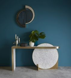 British stone specialist Lapicida launched the 'Collison' console by well known jewellery designer Lara Bohinc. Bohinc launched her 'Collison' console table for Lapicida at Maison & Objet. Made from marble and brass, the design features an intersecting disc wrapped in brass that supports its narrow shelf.