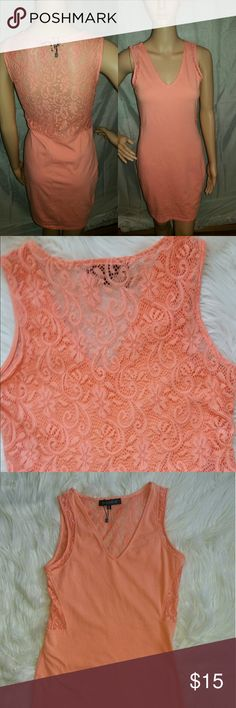 Dynamite Lace Back Peach Body Con Dress This Dynamite Dress is Spring time ready. Has lace on the side on both sides of the waist and back. So cute for a night out or a day trip. Very stretchy 95 % cotton with 5% spandex. MEGA STRETCH. V Neck neckline that shows just enough. The peach color is so flattering on all skin tones. No flaws new with out tags  Measurements Flat:  Pit to Pit : 17 inches  Waist: 31 inches  Length:35 inches Dynamite Dresses