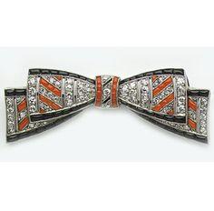Art Deco Calibré coral, calibré onyx, diamond and platinum bow brooch.