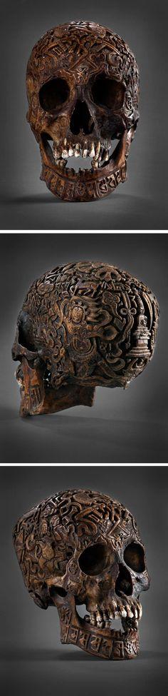 Tibetan carvings on human skull creepy...but cool as shiznet!