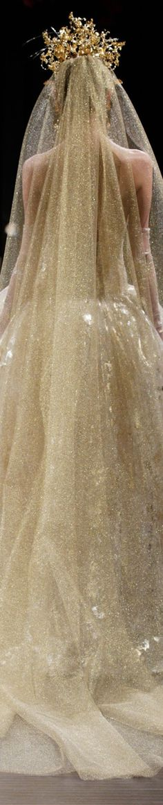 The Midas Touch from Naeem Khan. Beautiful gold gown and veil. Unforgettable.