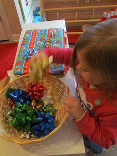 "Put small magnets on the back of bows and wrap a metal baking sheet in paper - let kids ""decorate"" to their heart's content."