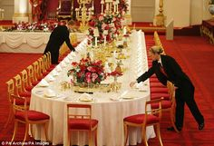 Staff members lay the state banquet table as part of a display for the Buckingham Palace summer opening Duchess Of Cornwall, Duchess Of Cambridge, Buckingham Palace, St James's Palace, Palace London, Winfield House, Windsor, Mrs May, Eric Trump