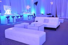 Lounge area - white sofas - blue lights - ice atmosphere - enlighted bar consolle - white tents