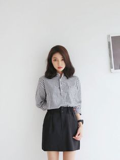 I might try a dark green skirt with buttons, and a checked shirt like this urbanKOREA