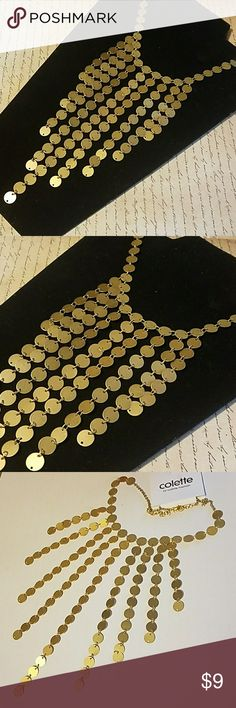 """9 Dangle Gold Disc Bib Style Necklace 16"""" Gold necklace with lobster clasp closure. 9 rows of gild discs (longest being @ center measuring 7"""" drop from neckline. Item#N691 **25% OFF BUNDLES OF 3 OR MORE ITEMS** REASONABLE OFFERS ACCEPTED!  *ALL JEWELRY IS NWT/NWOT/UNUSED VINTAGE* ALL CLOTHING IS NWT/GENTLY USED & CHECKED FOR ANY DAMAGE. IF ANY ITEM IS DAMAGED, IT WILL BE NOTED & SHOWN. Colette Hayman Jewelry Necklaces"""