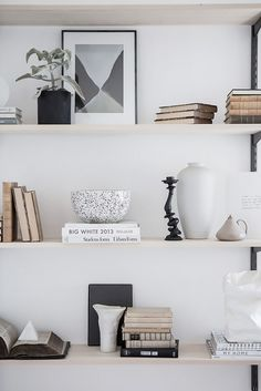 Styled shelf with books, pottery and a overall monochrome color palette