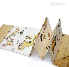'Map for Finding Yesterday' by Mia Leijonstedt. Concertina book. This book draws its inspiration from antique maps. The light-weight drift wood covers continue the imagery in material form. Imaginary, symbolic writing is burnt through the pages – the effect of which adds to the concept of time when the book is viewed against a light source.